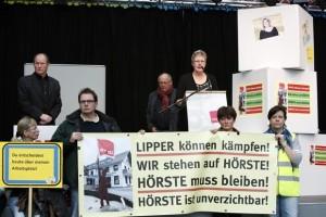Beschäftigte aus Lage-Hörste argumentierten vor dem Gewerkschaftsrat in Berlin gegen die Schließung der Bildungsstätte Foto: Christian von Polentz
